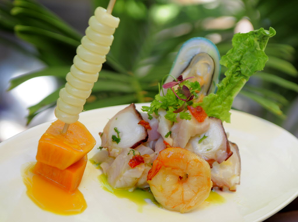 (Dec 9, 2010) (Sarasota Herald-Tribune photo by Dan Wagner) Mixed ceviche, including fresh fish, shrimp, mussels and octopus, in yellow pepper lime juice with cilantro, red onions, Cuzco corn and yam is served at The Cottage on the Key.