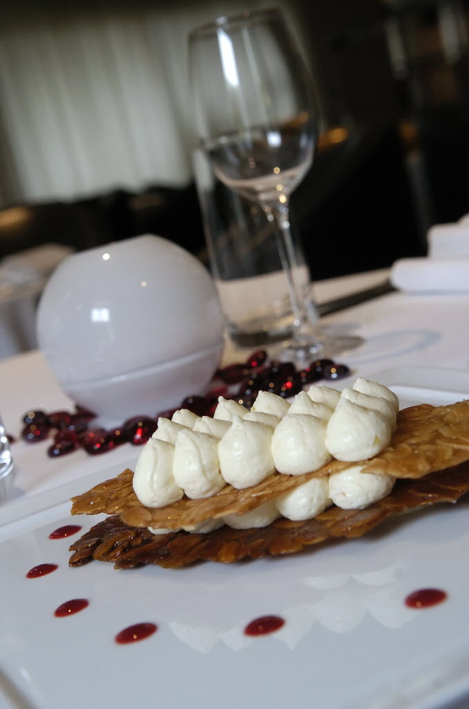 An almond nougatine with lemon curd mousse and a raspberry coulis is a specialty of the day at Maison Blanche.  (2.2.10; STAFF PHOTO / E. SKYLAR LITHERLAND)