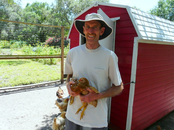 COOPED UP: Peter Burkard in his backyard chicken coop / COOPER LEVEY-BAKER