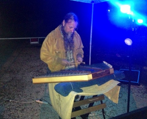 "Phil Anderson of ""Hammered Music"" performed outside The Village Mystic at Friday's music festival."